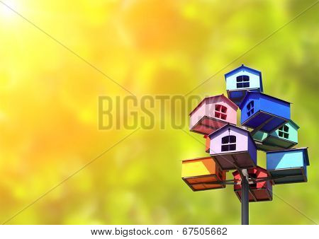 Colorful nesting boxes on green background