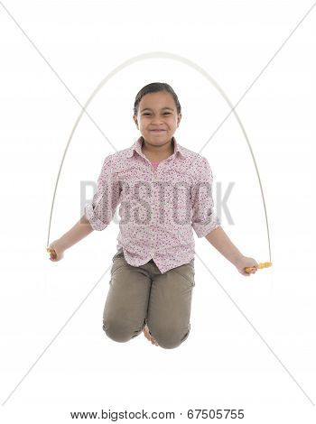 Young Girl Jumping With Skipping Rope