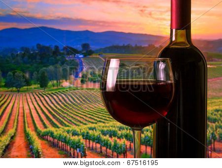 Glass With Red Wine And Bottle, Atmosphere Sunset
