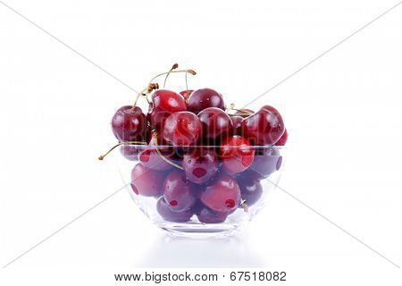 cherries on glass cup isolated on white background