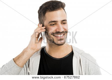Happy young man talking on cell phone isolated on white background