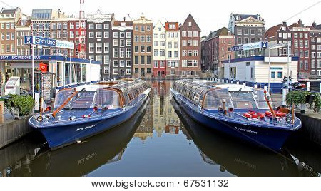 Water Canal And Typical Architecture In Amsterdam, Netherlands