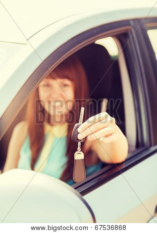 vehicle, rental, automotive concept - happy woman holding car key