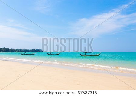 White Sand Beach And Boats