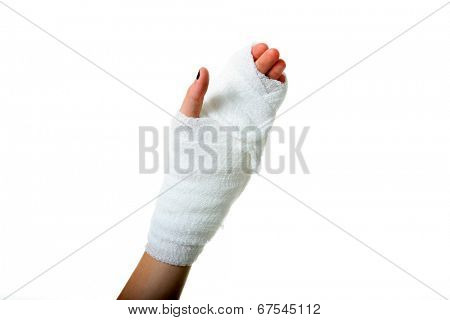 a persons hand wrapped in a gauze bandage. Isolated on white with room for your text. Gauze bandages are an important tool in the United States Health Care Industry as a cheap fix for sprains