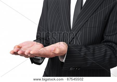 man wearing a suit with his hands open, as begging or showing or holding something