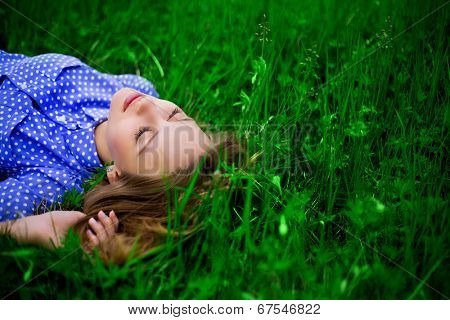 beautiful young woman outdoor on the grass
