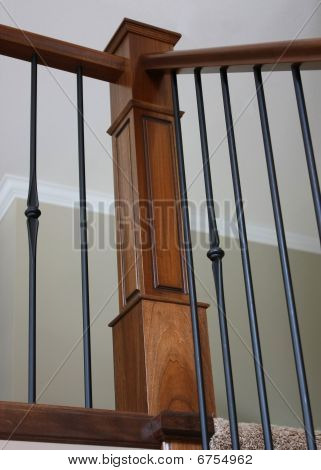 Corner bannister, wrought iron and oak