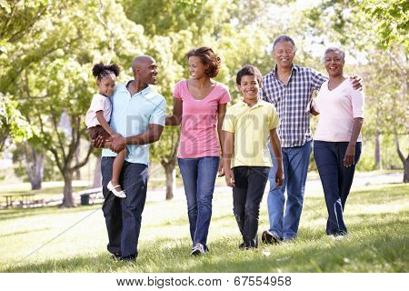 Multi-generation  family walking in park