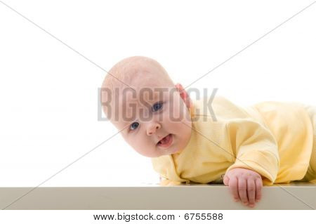 Young Baby Boy Creeps On A Table