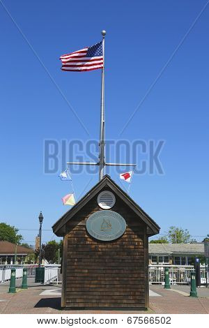 American flag and nautical flags flying at Woodcleft Esplanade in Freeport, Long Island