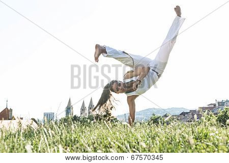Capoeira woman awesome stunts in the outdoors