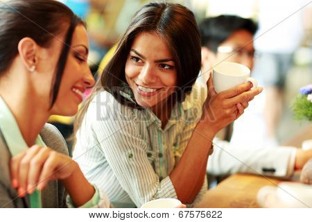 Portrait of young smiling businesswomen having coffee break