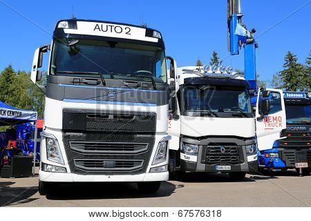 White Volvo And Renault Trucks