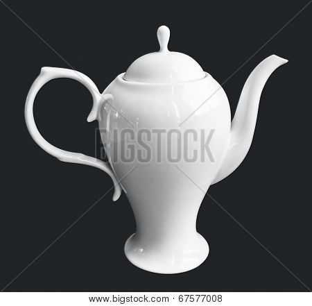 White Ceramic Teapot and milk pot on isolate black background