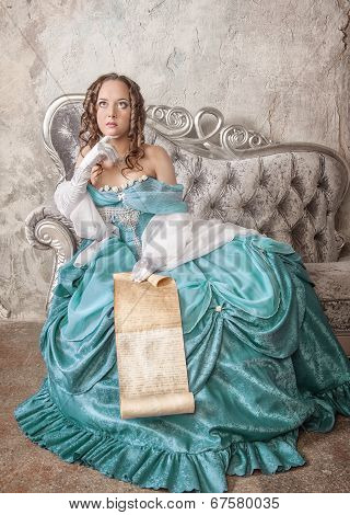 Beautiful Woman In Medieval Dress With Scroll Letter