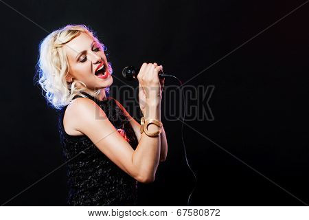 Beautiful singing woman with microphone. Singer. Karaoke song