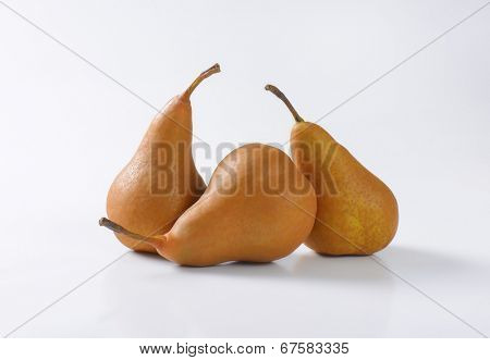 three whole ripe pears