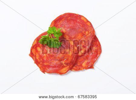 three slices of spanish chorizo