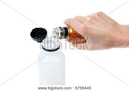 Pouring Alcohol In Water Bottle