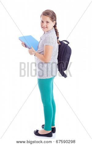 Full body portrait of a school girl with backpack holding notebooks, isolated on white background