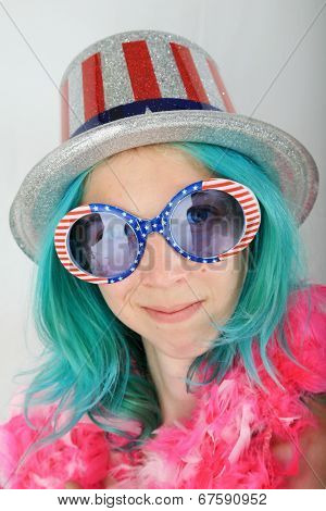 A Young Woman With Blue Hair gets ready for the Big 4th of July Celebration by wearing the colors of the US Flag. Red, White and Blue.