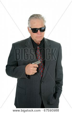 A well dress man pulls his Pocket Pistol from his vest pocket when he faces danger as a CIA Mole or Mafia King Pin or some other nefarious Character.  isolated on white with room for your text.