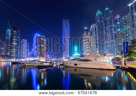 DUBAI, UAE - 31 MARCH 2014: Cayan Tower skyscraper in Dubai Marina at night, UAE. Cayan tower with 306 metres high(1,004 ft) and 80 floors is a world's tallest high rise twisted building.