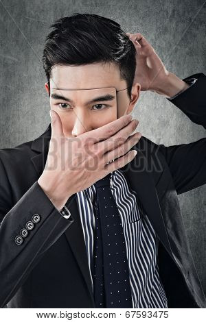 Asian business man in mask, concept of hide, cheat, lie etc.