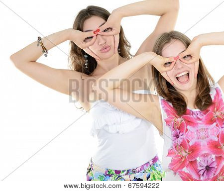 Portrait of a two teen girls have fun and make faces looking and searching something, isolated on white