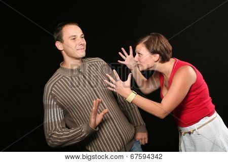 Couple having fight - woman very angry, man trying to ignore her