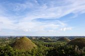 stock photo of chocolate hills  - Chocolate Hills and blue sky Bohol Island Philippines - JPG