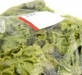 stock photo of iceberg lettuce  - iceberg lettuce in plastic bag package with price tag - JPG