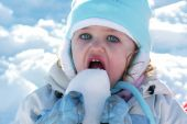 Young Toddler Eating Snow