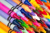 stock photo of pigment  - background of multicolored new crayons in rows closeup - JPG