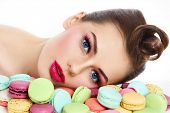 picture of pinup girl  - Portrait of young beautiful woman with colorful macaroons over white background - JPG