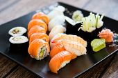 image of dragon-fish  - Japanese seafood sushi set on black background - JPG