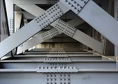 stock photo of girder  - The underside of a bridge with large steel girders bolts and nuts - JPG