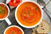 stock photo of pepper  - Roasted red pepper and carrot soup in white bowl - JPG