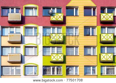 Windows And Colorful Facade Of Residential Building.