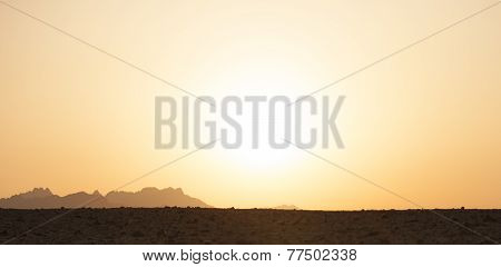 Landscape Of Sunlit Sky Above The Desert Sand And Dunes
