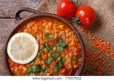 Red Lentil Soup With Tomatoes And Lemon Horizontal. Top View