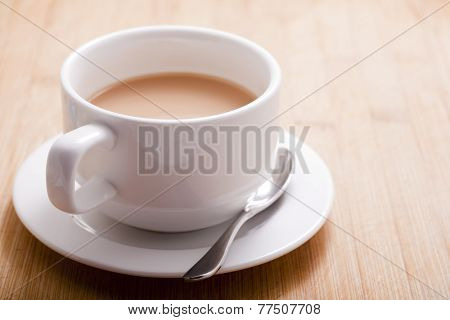 coffee cup on wooden board.