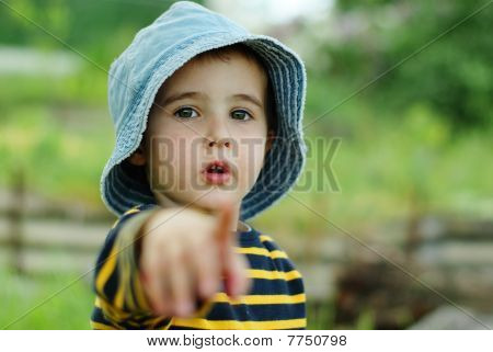 Little Boy Points To The Camera