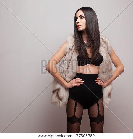 Fashionable Model Wearing Fur Vest And Black Lingerie. Black Stockings