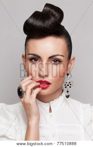 Close Up Of Vintage Styling Model With Makeup And Updo. Accessories. Red Lips. White Lacy Shirt