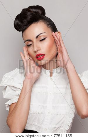 Fashionable Emotive Model. Updo, Vintage Accessories. Makeup And Hairstyle. Red Lips, Large Earrings