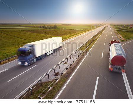 Two Trucks In Motion Blur On Highway