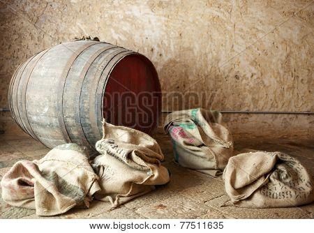 Old Barrel With Burlap Sacks.