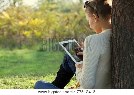 Colorful Close Up Of Using tablet Young Woman In The Park. Touching Touchscreen